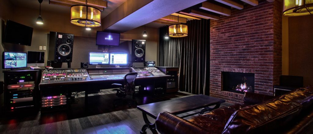 an elaborate home studio with console and outboard